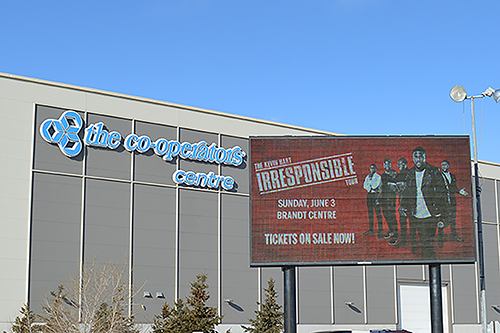 A screen advertising Kevin Hart's upcoming show in Regina