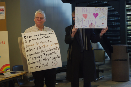 Anti-gay, anti-abortion activist Bill Whatcott, left, is interrupted by a protester at the University of Regina. Photo by Eric Westhaver, INK Online.