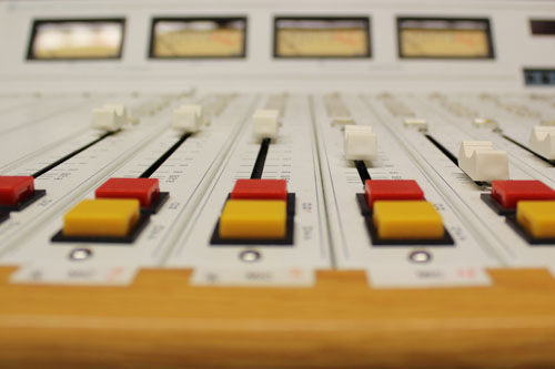 Two afternoon radio hosts are out of work after a program revamp at 980CJME. Photo illustration by Kyrsten Stringer.