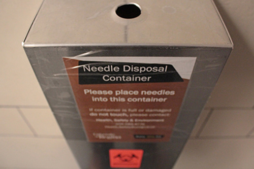 Bin for disposing used needles.