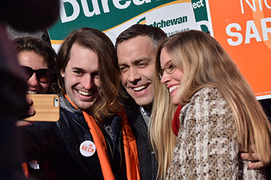 NDP leader Cam Broten poses with supporters before the leaders' debate on March 23.