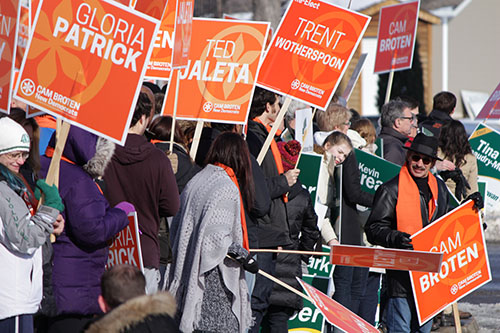 NDP supporters rally outside before the leaders' debate on March 23.