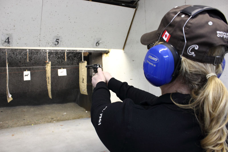 Dawn Davey shoots a handgun at the shooting range at the Saskatoon Wildlife Federation clubhouse
